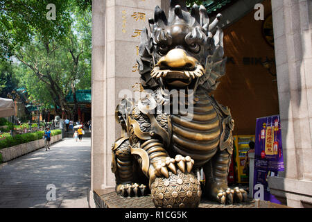 Sculpture stone Qilin dragon guardian at entrance of Wong Tai Sin Temple for people visit and respect praying at Kowloon on September 9, 2018 in Hong  - Stock Photo