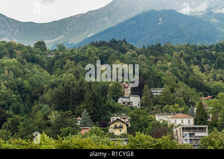 Alps in Innsbruk, Austria with beautiful houses - Stock Photo