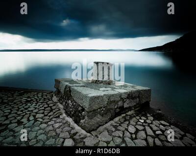 Lonesome bollard on concrete post long exposure Dirakovica Dramalj near Crikvenica in Croatia - Stock Photo
