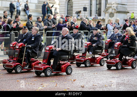 London, UK. 11th Nov, 2018. War veterans take part in the annual Remembrance Sunday on the Centenary of the Armistice procession in London to pay tribute to those who have suffered or died during war. Hundreds of people gathered together to mark the centenary of the Armistice, which saw 3,123 members of the armed forces losing their lives. The armistice ending the First World War between the Allies and Germany was signed at Compiegne, France on the eleventh hour of the eleventh day of the eleventh month - 11am on the 11th November 1918. (Credit Image: © Dinendra Haria/SOPA Im - Stock Photo