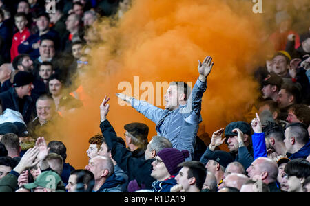 London, UK. 11th Nov 2018. Wolverhampton supporters celebrate with 'orange' during the Premier League match between Arsenal and Wolverhampton Wanderers at the Emirates Stadium, London, England on 11 November 2018. Photo by Phil Hutchinson.  Editorial use only, license required for commercial use. No use in betting, games or a single club/league/player publications. Credit: UK Sports Pics Ltd/Alamy Live News - Stock Photo