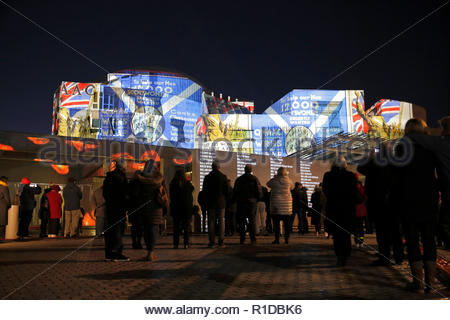 Edinburgh, United Kingdom. 11th November, 2018.  The Scottish Parliament building illuminated on Armistice day with images that tell the story of the world war 1 conflict alongside a Roll of Honour of those who died.   Credit: Craig Brown/Alamy Live News. - Stock Photo