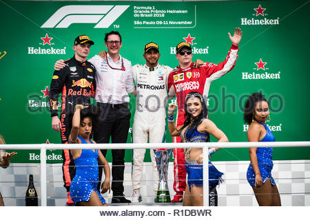 Sao Paulo, Brazil. 11th Nov 2018. Max Verstappen, Red Bull Racing, 2nd position, Andrew Shovlin, Chief Race Engineer, Mercedes AMG, Lewis Hamilton, Mercedes AMG F1, 1st position, and Kimi Raikkonen, Ferrari, 3rd position, on the podium during the Brazilian GP at Autódromo José Carlos Pa on November 11, 2018 in Autódromo José Carlos Pace, Brazil. Credit: Motorsport Images/Alamy Live News - Stock Photo
