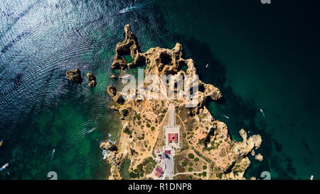 Aerial view of Ponta da Piedade of Lagos, Portugal. Rugged seaside cliffs and aqua ocean waters in the Algarve region of Portugal - Stock Photo