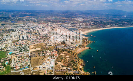 Aerial view of cliffs and beach near Lagos city in Algarve coast at Portugal - Stock Photo