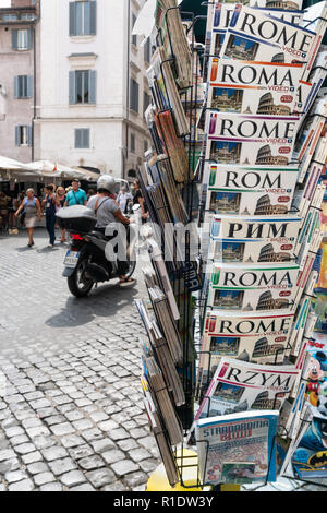 Tourist Guidebooks to Rome in a variety of languages, on sale in the Campo De Fiore,  Rome, Italy. - Stock Photo