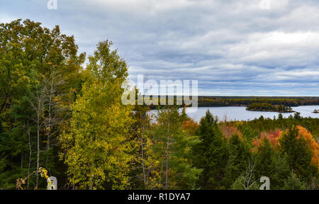 View of the ausable river valley from a vista at canoers monument. This vista is located in the Hurona National Forest. The changing colors helped. - Stock Photo