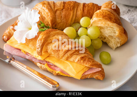 Breakfast or lunch Ham and Cheese Fresh baked Croissant Sandwich - Stock Photo