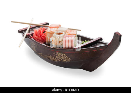 close up of sashimi sushi set with chopsticks and soy on a black serving boat tray - Stock Photo