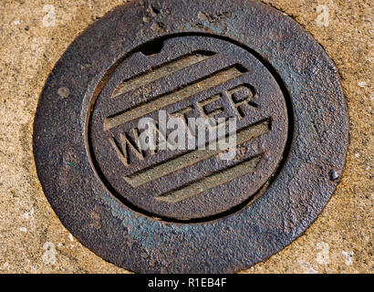 A rusted water meter manhole cover is pictured on Dauphin Street, Nov. 3, 2018, in Mobile, Alabama.  (Photo by Carmen K. Sisson - Stock Photo