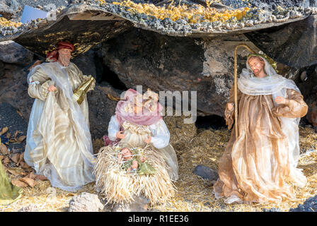 Christmas Nativity scene showing the cave with the baby Jesus, Mary and Joseph in Lanzarote. - Stock Photo
