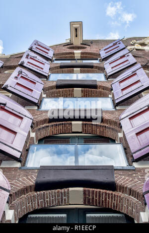 House with shutters in Amsterdam on a sunny day - Stock Photo