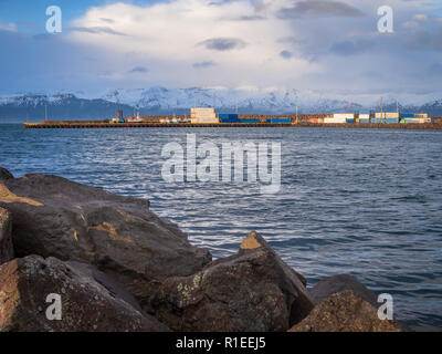 Harbor of Husavik, Iceland in the early morning - Stock Photo