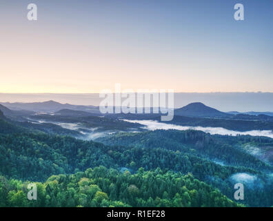 Sunset hills over clouds landscape in Bohemia. Beginning of autumn - Stock Photo