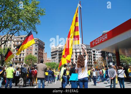 Catalans wave flags during a Llibertat Presos Politics (Free Political Prisoners) march in central Barcelona, Spain on April 15, 2018. - Stock Photo