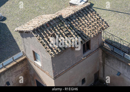 Small house with an old roof top view. Old house in Rome. - Stock Photo