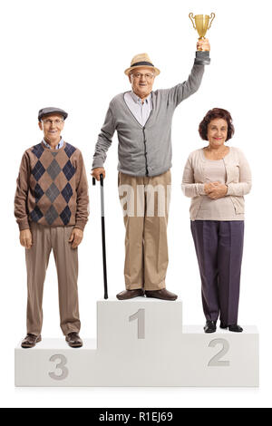 Full length portrait of senior people on a winner's pedestal for first second and third place isolated on white background - Stock Photo