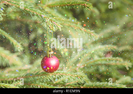 Christmas and New Year red Decoration. Holiday Background. Blinking Garland. Christmas Tree Lights Twinkling. Glowing red ornaments.Blinking Garland. Christmas Tree in Lights.Copy space - Stock Photo