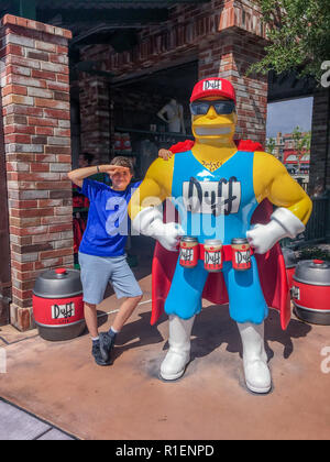 APRIL 25, 2018 - ORLANDO, FLORIDA: TWELVE YEAR OLD BOY WITH DUFF CHARACTER FROM THE SIMPSONS AT UNIVERSAL STUDIOS. - Stock Photo