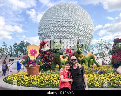 APRIL 25, 2018 - ORLANDO, FLORIDA:FATHER AND SON AT EPCOT. - Stock Photo