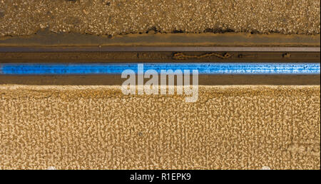 The lost bike chain in the rail bed - Stock Photo