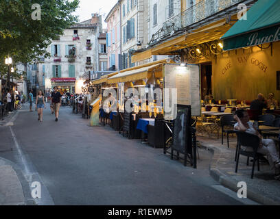 Arles, France - June 24, 2017: People sitting at a cafe in Place du Forum, Arles, Provence, France. - Stock Photo