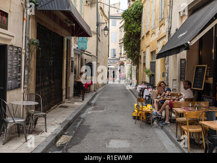 Arles, France - June 24, 2017: Cafe and restautants in the old town of Arles in Provence in the South of France. - Stock Photo