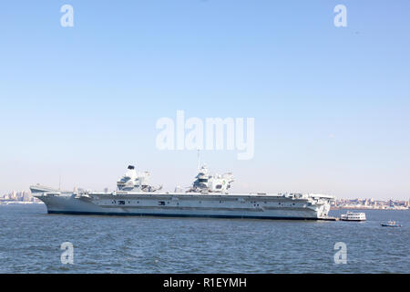 HMS Queen Elizabeth Aircraft Carrier, the Royal Navy's largest and newest warship, moored New York harbor, United States of America. - Stock Photo