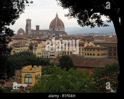 view over Florence from San Miniato hill above the gate of San Niccolò towards The Duomo, Brunelleschi's Dome and Giotto's campanile in Florence,Italy - Stock Photo