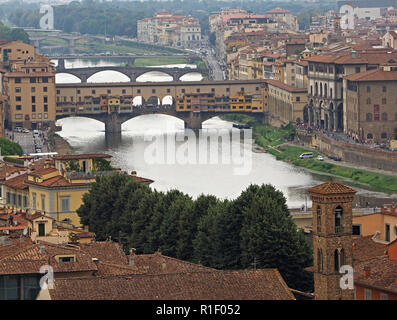 view over Florence down the River Arno towards iconic mediaeval Ponte Vecchio from San Miniato hill above gate of San Niccolò Florence,Italy - Stock Photo