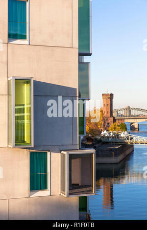 the hotel Artotel at the Rheinau harbor, in the background the Malakoff tower, Cologne, Germany.  das Hotel Artotel im Rheinauhafen, im Hintergrund de - Stock Photo