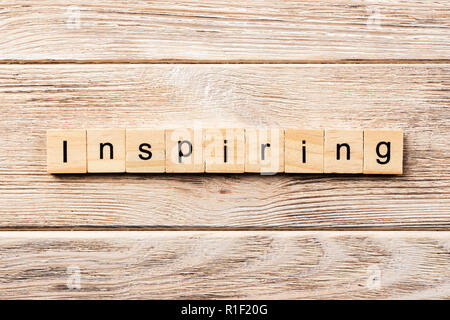 inspiring word written on wood block. inspiring text on table, concept. - Stock Photo
