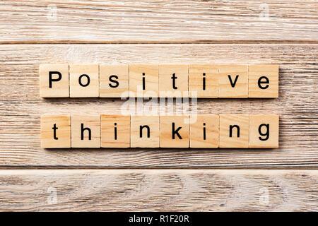 positive thinking word written on wood block. positive thinking text on table, concept. - Stock Photo