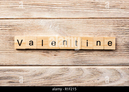 valentine word written on wood block. valentine text on table, concept. - Stock Photo