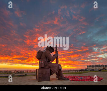 'Tommy' at dawn on Remembrance Sunday, Seaham, County Durham, UK - Stock Photo