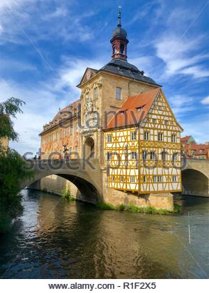 Bamberg is an old town in Germany with very charming historic wood-framed architecture seen in many of its buildings. - Stock Photo