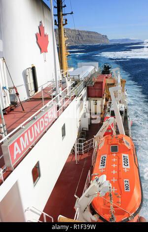 Canadaian Coast Guard Ship Amundsen steaming along Lancaster Sound beside Devon Island, Eastern Arctic - Stock Photo