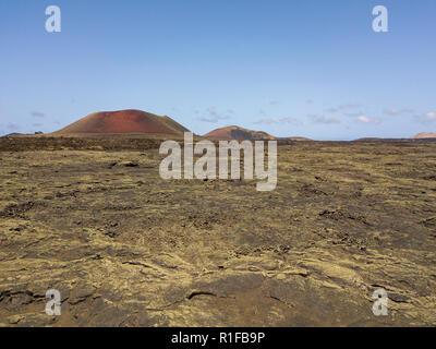 Aerial view Caldera Colorada volcano, lava field with lichens, Lanzarote, Canary Islands, Spain, Europe - Stock Photo