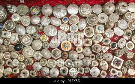 Silver jewelery in the display of a shop in Muscat. Such ironwork is part of traditional craftsmanship in Oman.   usage worldwide - Stock Photo
