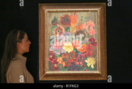 Bonhams. London, UK. 12th Nov, 2018. A staff member looks at 'Panel of Flowers' by Cedric Morris (1889-1982) oil on canvas (Estimate £30,000-50,000). Bonhams Modern British and Irish Art preview. Auction to be held on 14 November 2018. Credit: Dinendra Haria/Alamy Live News - Stock Photo