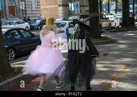 CHARLOTTE, NC, USA-10/31/18: Two women dressed for Halloween as good and evil witches. - Stock Photo