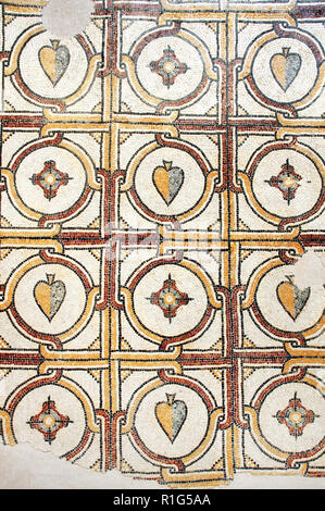 Ancient byzantine natural stone tile mosaics with with geometric patterns, Mount Nebo, Jordan, Middle East - Stock Photo