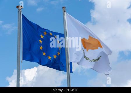 The European Union and Cyprus flag flying on flagpole, Kouklia, Pafos District, Republic of Cyprus - Stock Photo