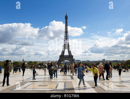 Tourists in the Place du Trocadéro overlooking the Eiffel Tower, Paris, France - Stock Photo