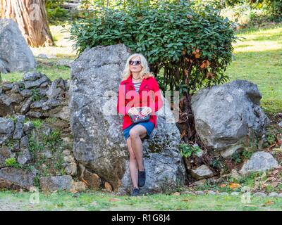 Attractive senior woman 40-45 years caucasian appearance blonde hair wearing sunglasses - Stock Photo