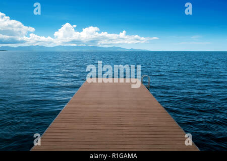 wooden pontoon vanishing in the sea,Petit Canal, Guadeloupe, French West Indies - Stock Photo