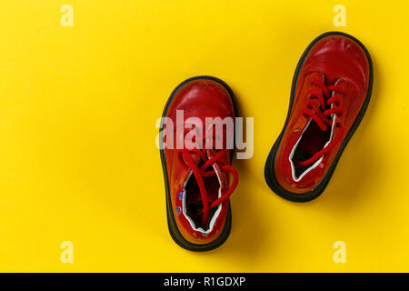 children's autumn red leather shoes on a yellow background. space for text - Stock Photo