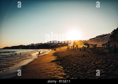 Sunset on the beach in Albufeira, Algarve district, Portugal - Stock Photo
