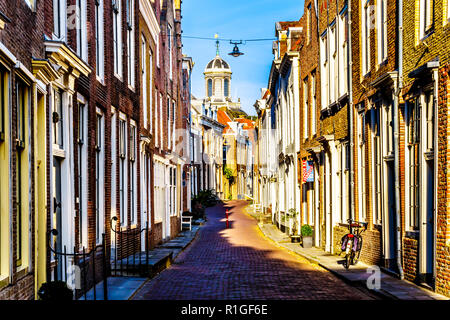 Sunset over Narrow Streets in the Historic City of Middelburg in the province of Zeeland in the Netherlands - Stock Photo