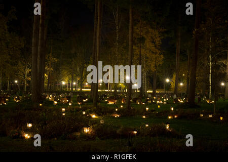 All the saints evening at the cemetery in Katrineholm Sweden, Beautiful night with light from burning candles - Stock Photo